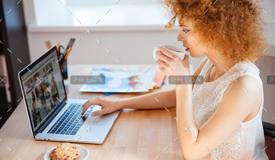 demo-attachment-177-woman-photographer-drinking-coffee-and-working-PJNBP6U